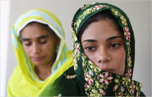 Assiya Rafiq, right, in front of her mother, Iqbal Mai. (Nicholas D. Kristof/The New York Times)